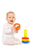Small child play with toys on white background. Baby play with toys on white background in studio Royalty Free Stock Photos