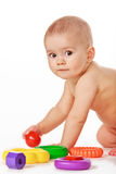 Small child play with toys on white background Royalty Free Stock Photography