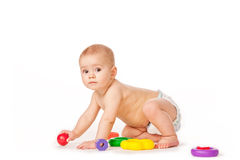 Small child play with toys on white background. Baby play with toys on white background in studio Royalty Free Stock Photography