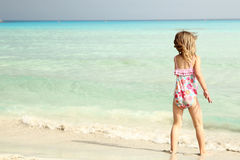 A small child playing on the beach Stock Image
