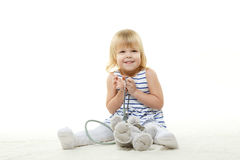 Small child playing the doctor . Royalty Free Stock Photos