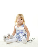 Small child playing the doctor . Royalty Free Stock Photo
