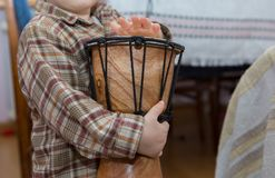Small child playing on drum Royalty Free Stock Photography