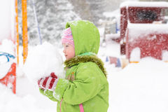 Small child playing with first snow Stock Image
