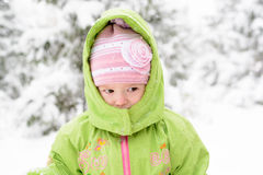 Small child playing with first snow Royalty Free Stock Photos