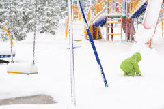 Small child playing with first snow Stock Photography