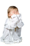 Small child playing hide and seek Royalty Free Stock Photography