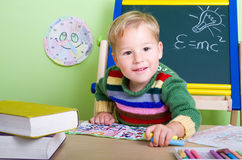 Small child playing school Royalty Free Stock Photography