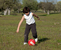 Small child playing soccer Stock Photography