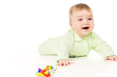 A small child is playing with toys Royalty Free Stock Photo