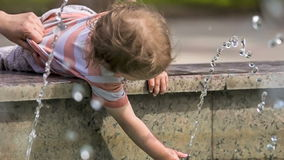 Small Child  Playing With Water In Fountain stock video