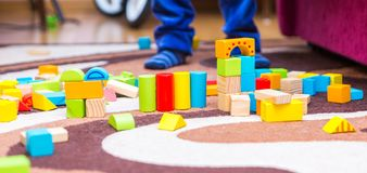 Small child playing with wooden blocks Royalty Free Stock Images