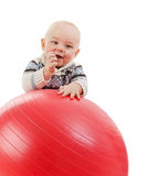 Small child plays with ball Royalty Free Stock Image
