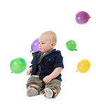 The small child plays with balls Stock Photo