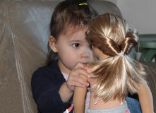 Small Child Plays with her Doll Stock Image