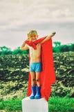 A small child plays a superhero. royalty free stock photos
