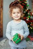 Small child with a present. The concept of Christmas. Stock Images