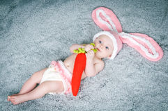 Small child with rabbit ears. Royalty Free Stock Images