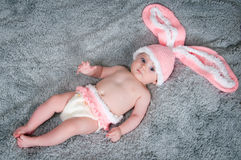 Small child with rabbit ears. Royalty Free Stock Photography