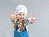 Small child reaching out with her hands Stock Images