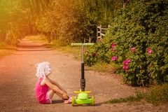 A small child is resting on the road royalty free stock photography