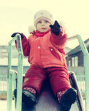 Small child is riding a roller coaster Royalty Free Stock Image