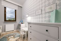 Small child room in modern apartment. Small child room in pastel blue color Stock Images
