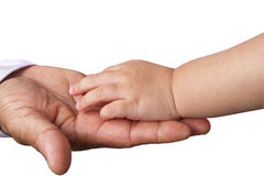 Small child's hand reaches for the big man or grand father hand. Isolated on white background royalty free stock photo