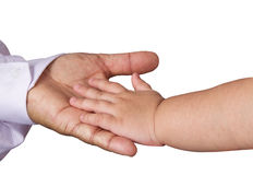 Small child's hand reaches for the big man or grand father hand. Isolated on white background royalty free stock image