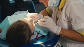 Small child's visit to the dentist stock video