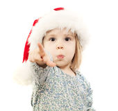 Small Child in Santa Hat Point her Finger Stock Image