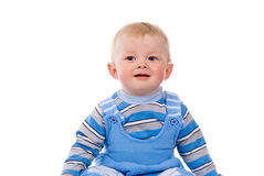 A small child sits stock photography