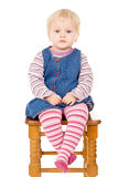 Small child sits Royalty Free Stock Photos