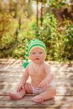 Small child sits in the hat Royalty Free Stock Photography