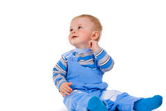 A small child sits and laughs Stock Photo