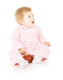 Small child sitting with apple Royalty Free Stock Images