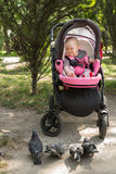 Small child sitting in a pram Royalty Free Stock Photo