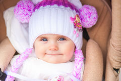 Small child sitting in a stroller in the afternoon. Royalty Free Stock Photography