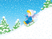 Small child sleighing Stock Image