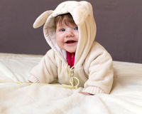 A small child smiling. A small child smiling, dressed in animal costume with ears Stock Photos