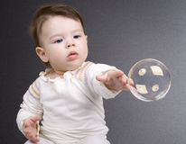 The small child and soap bubbles Royalty Free Stock Photo