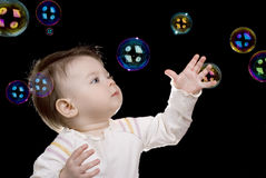 The small child and soap bubbles Stock Photos