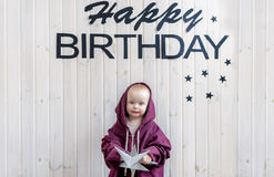 Small child standing in sports suit big size. Birthday of the kid. Royalty Free Stock Photography