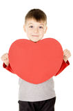 A small child stands and holds the heart. Isolated on white background Stock Image