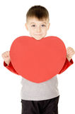 A small child stands and holds the heart. Isolated on white background Royalty Free Stock Image