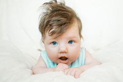 A small child stares at the camera. A small child in blue dress stares at the camera Royalty Free Stock Images