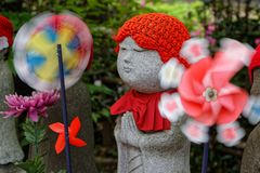 Small child statue with toys. In Zojo-ji temple park, Tokyo royalty free stock photo