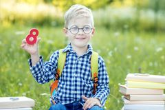 A small child is studying the numbers. Back to school. The concept of learning, school, mind, lifestyle and success. A small child is studying the numbers. Back royalty free stock image