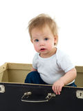 Small child in a suitcase. Small child sitting in a suitcase isolated on white Royalty Free Stock Images
