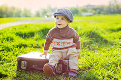 Small child on a suitcase Stock Photography
